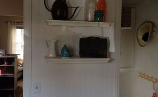 updated kitchen photo floor to ceiling bead board, kitchen design, wall decor, woodworking projects, Kitchen renovation floor to ceiling beadboard on one wall the only photo I took The lunch pail and clear glass jar were my maternal grandfather s and the blue glass and blue honey jar were my paternal grandmother s