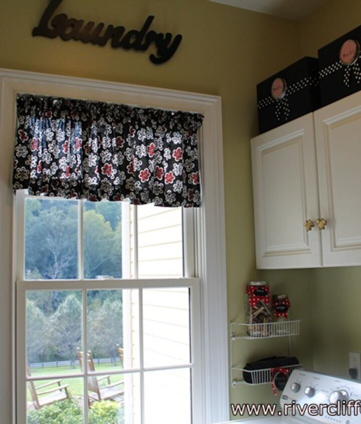 I made my valance from a black, red and white twill fabric which was $5.40 per yard.  It took 1 and 1/2 yards.  It's on a tension rod.