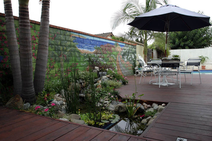 Create a unique deck setting by tucking a pond into the middle of it.