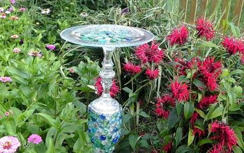 butterfly feeder tutorial using dollar tree items, crafts, gardening, repurposing upcycling, Here is my finished Butterfly Feeder It proudly sits between my zinnia and Bee Balm