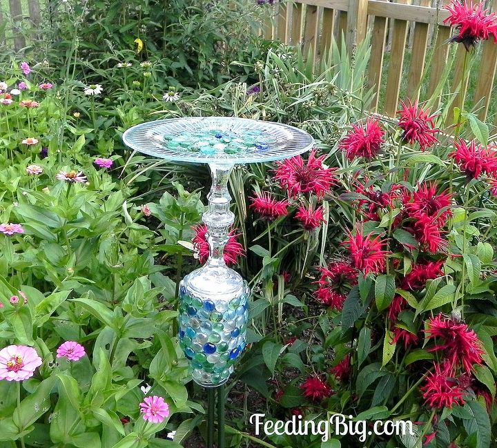 Here is my finished Butterfly Feeder.  It proudly sits between my zinnia and Bee Balm.