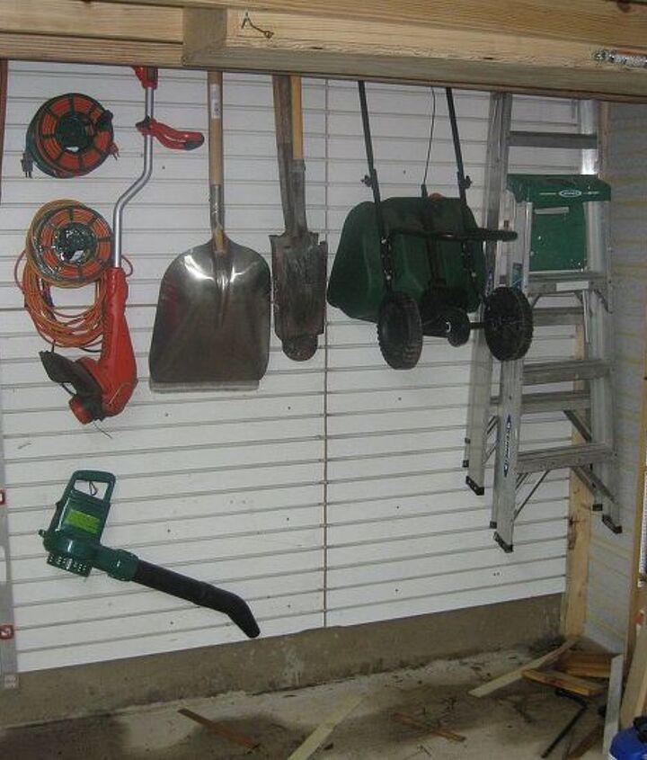Slatwall panels were hung to store yard tools away!