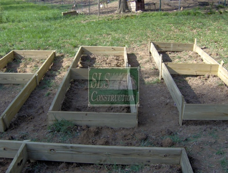 Check to make sure that the exterior of planter box is below ground level by at least one inch and that the box is level and square. If you are on a slope you can consider burying parts deeper or buildup the exterior