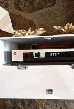 how to hide the cable box, home decor, storage ideas, As it looks when my guy is watching TV he s a channel changer