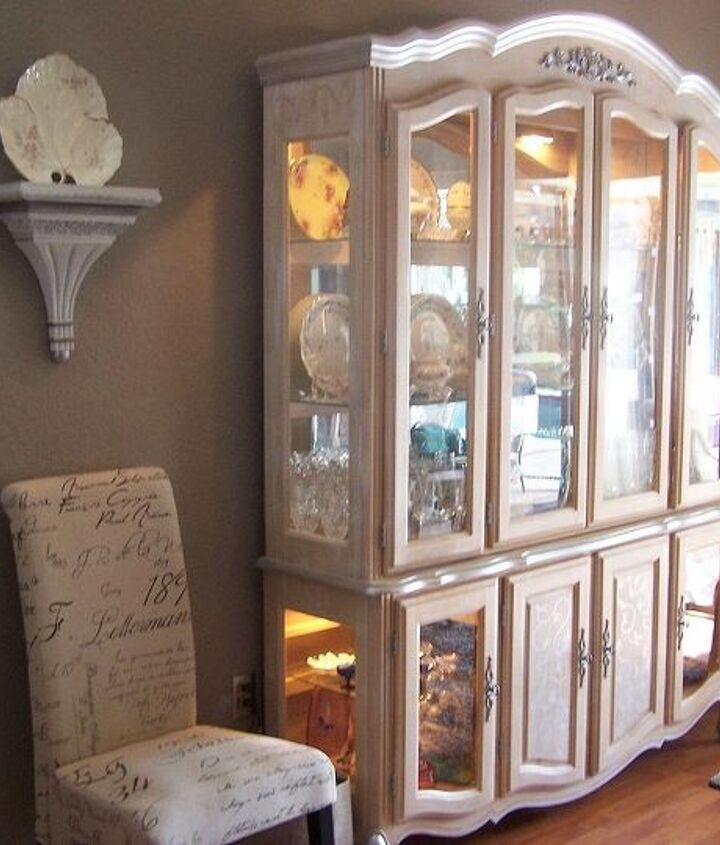 The hutch from Craig's list white washed with silver accents by a terrific artist also found on Craig's list