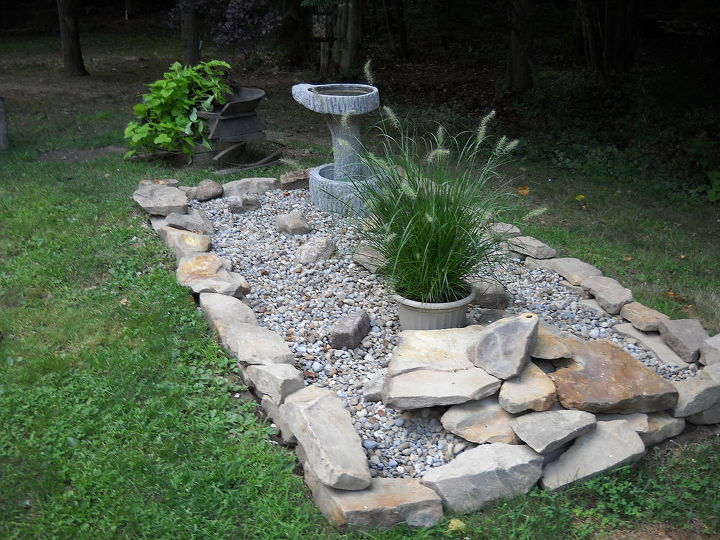 Disguising the septic system! Add river gravel, some stone, a great bird bath and wa-la! Easy to get to when we have to, and easy to find now!