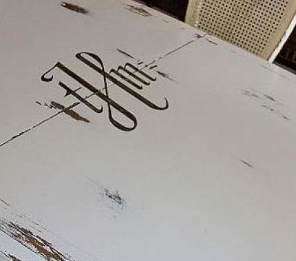 Monogram adds that special custom touch to this dining table.