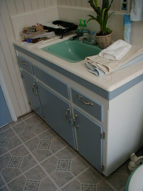 A vanity Demo was not an option so some creative painting with all new hardware helped it out a little.