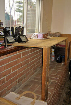 expanding a window sill with a two legged table, diy, how to, windows, woodworking projects, Once in place we tripled the width of the window sill