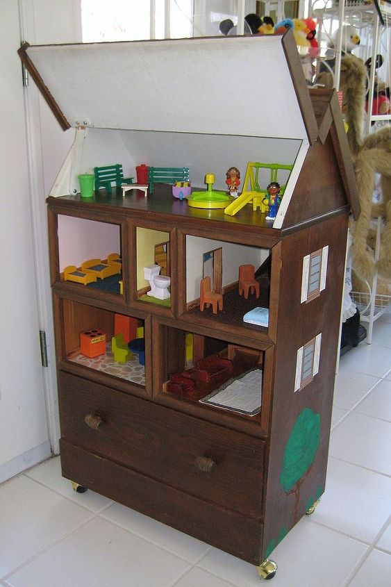 Dollhouse showing drawer and roof elevated