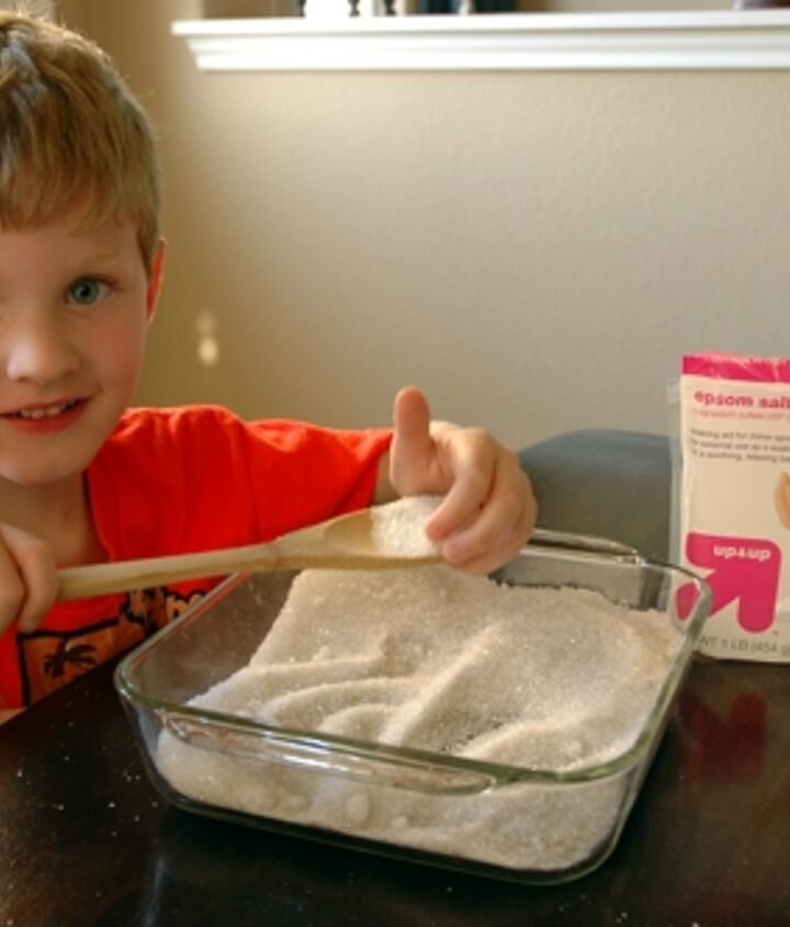 In a baking dish, mix together Epsom salt and glitter.  My then 5 year old helped me combine the ingredients.