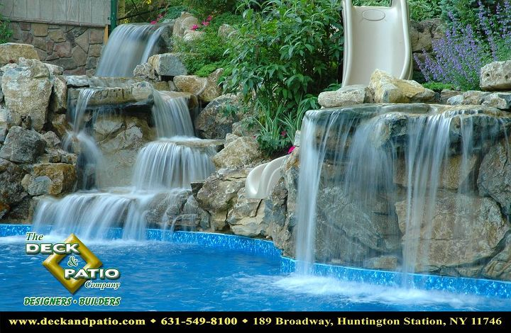 Pool with large waterfall and slide