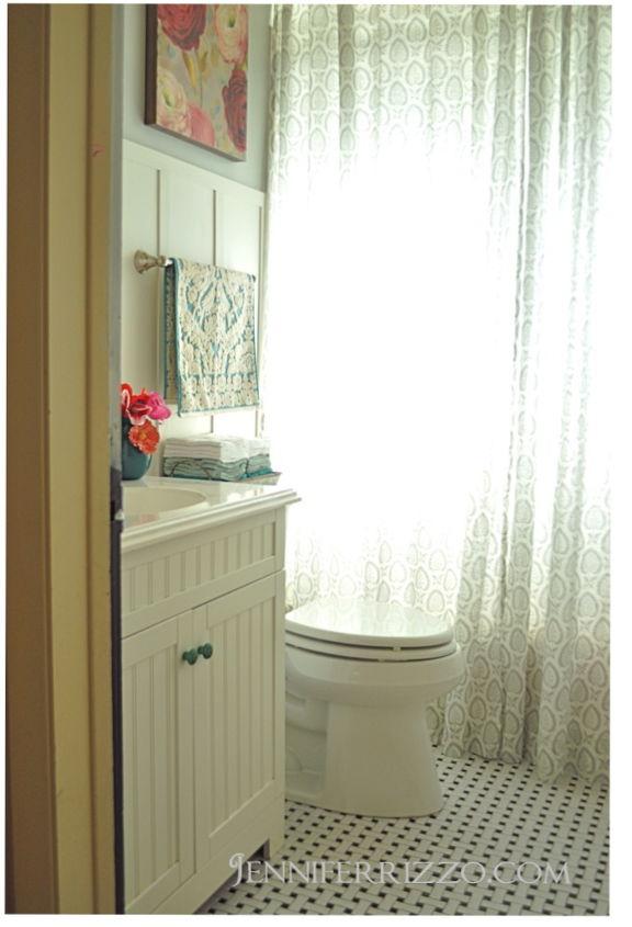 bathroom after: New vanity,toilet, floor, glass shelf and accessories