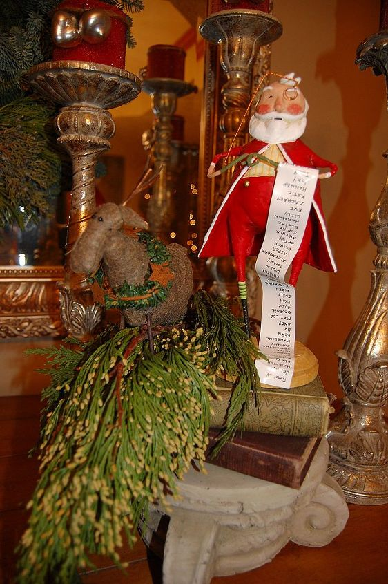 Love Lori Mitchell figurines.  Santa with his good girl & boys list.
