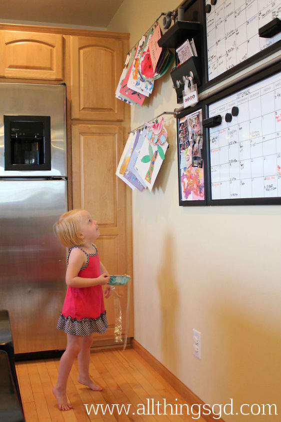 Kate loves seeing all her fun art work showcased on the wall!  She'll often ask us to clip new projects up when she brings them home, or take something down so she can play with it.