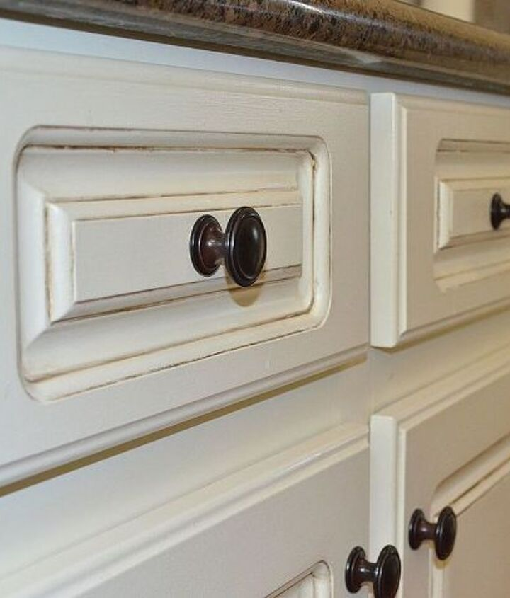 Close up view of painted and glazed drawers.
