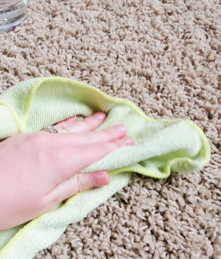 Use a damp cloth to rinse out soap and remaining stain.