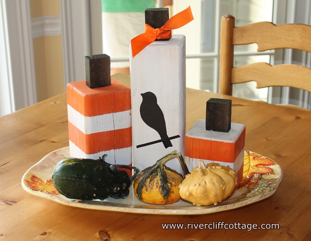 """Something inexpensive and easy for fall.  """"Pumpkin Blocks"""" probably started off as orange with the little plug in the top, but they are now striped, polka dotted, etc.    I went the easy, striped method or just left them plain."""