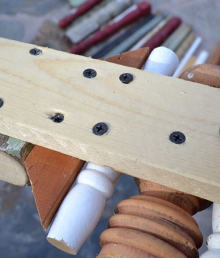 4. Screw on the spindles from the back.  I worked from the top down the tree.