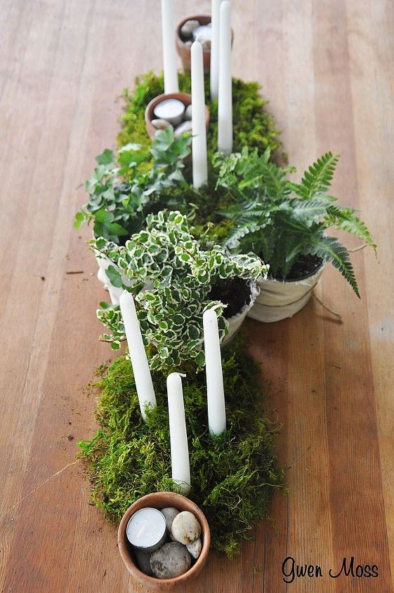 moss and candles and small ferns