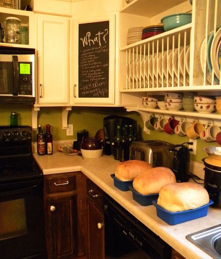 2 years ago....Added a chalkboard to one cabinet door, extended the height of the cabinets, corbels under cabinets, my  handmade plate rack by my husband, sanded and stainded the bottoms walnut.