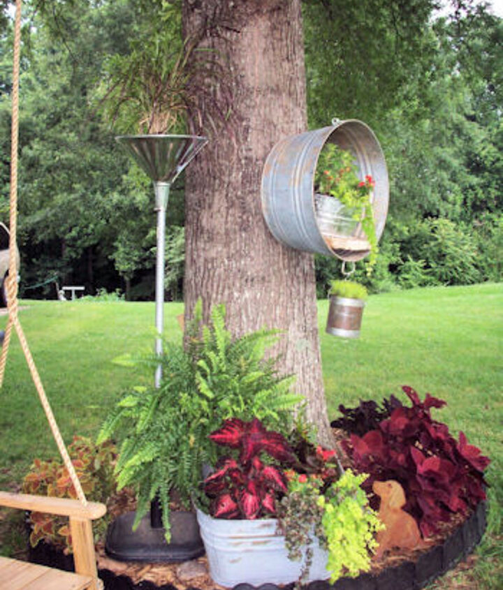 I ran out of space in this tree circle – so MWHP (My Wonderful Hubby Phil) had the idea to move the washtub up – way up on the tree itself!