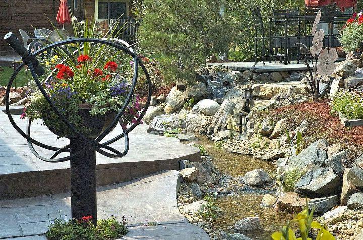 rocky mountain waterscape s garden kaleidoscope, flowers, gardening, The kaleidoscope looks great next to this stream