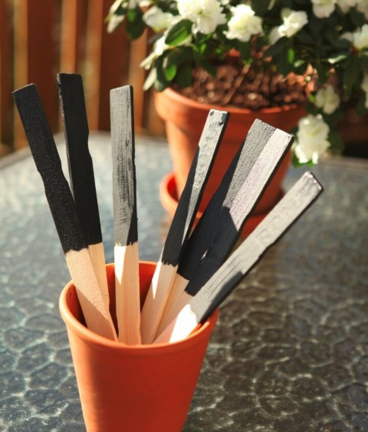 chalkboard paint plant markers, chalkboard paint, crafts, gardening, Once your paint is prepared you can tape off a section of your stick or just wing it You will dip the stick into the paint and use your brush or roller to make sure the excess is removed