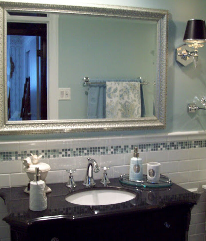 Here is the mirror from a resale shop and I love it.  Perfect size, color and price!  Continue the white subway tile from the bathtub onto the wall behind the vanity and a small line of glass accent tile.