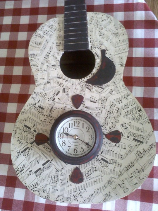 Decoupaged Guitar Turned Into Wall Clock Hometalk