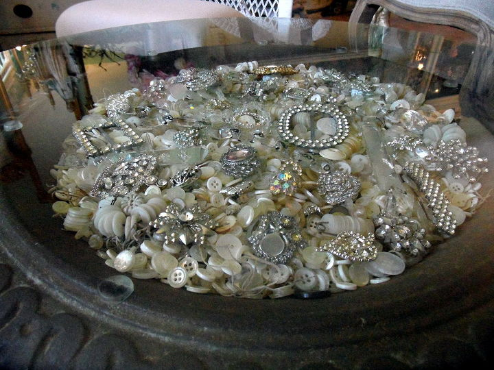 I filled it with bone and mother of pearl buttons. Be sure to plug up any drain holes so things don't fall out. You can also use something under the buttons or other filler, if you don't have enough. I used brown paper grocery bags.