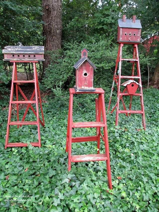 Mount birdhouses on old ladders to create functional garden accents.I painted the ladders and the birdhouses in the same barn red to make them a grouping. They bring color to a shady area covered in ivy.Best of all, they are occupied!