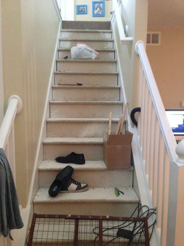 q stair remodel, diy, flooring, stairs, All the carpet is off but I m left with plain old plywood