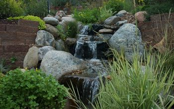 water features through walls, gardening, landscape, outdoor living, ponds water features, wall decor, A 75 stream with several ponds meanders through this Golden Colorado hillside and ends in a beautiful koi pond