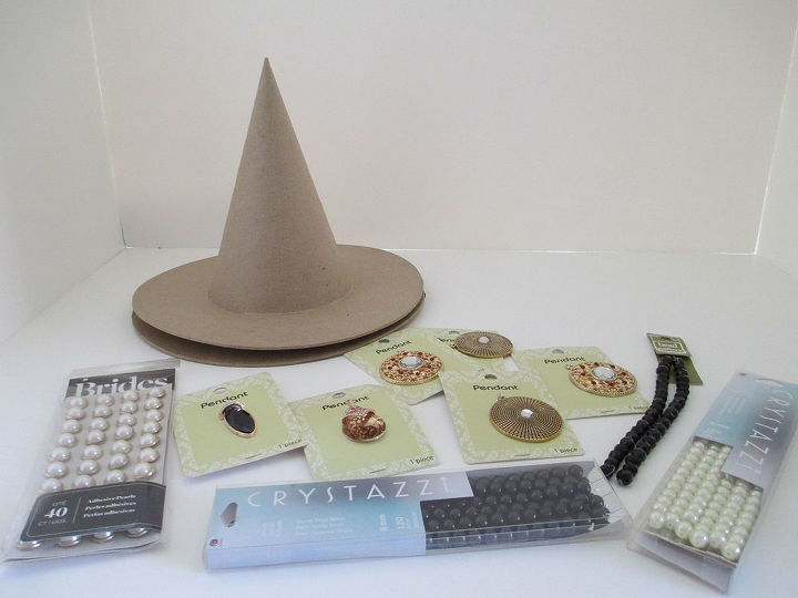 All supplies from Michael's. Cardboard witches hat, pendants and strings of pearls.