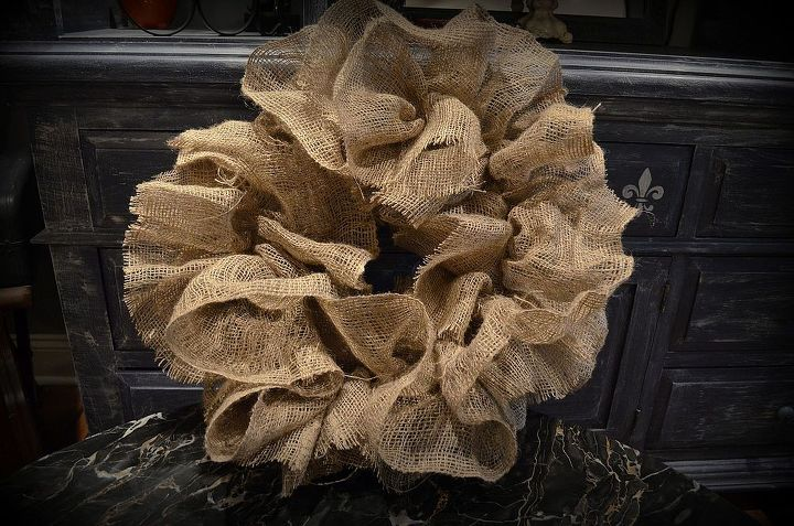 Working the shape of the burlap Wreath, Hot glued to Styrofoam wreath.