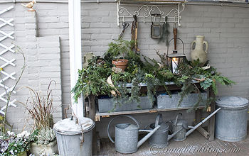christmas outdoor decor, outdoor living, seasonal holiday decor, The garden workbench got and easy and rustic look with lots of greenery