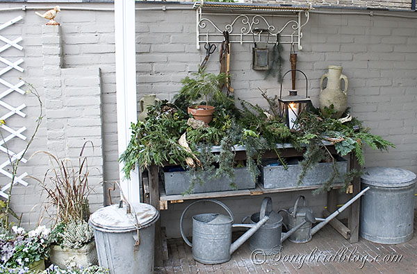 The garden workbench got and easy and rustic look, with lots of greenery. - Christmas Outdoor Decor Hometalk