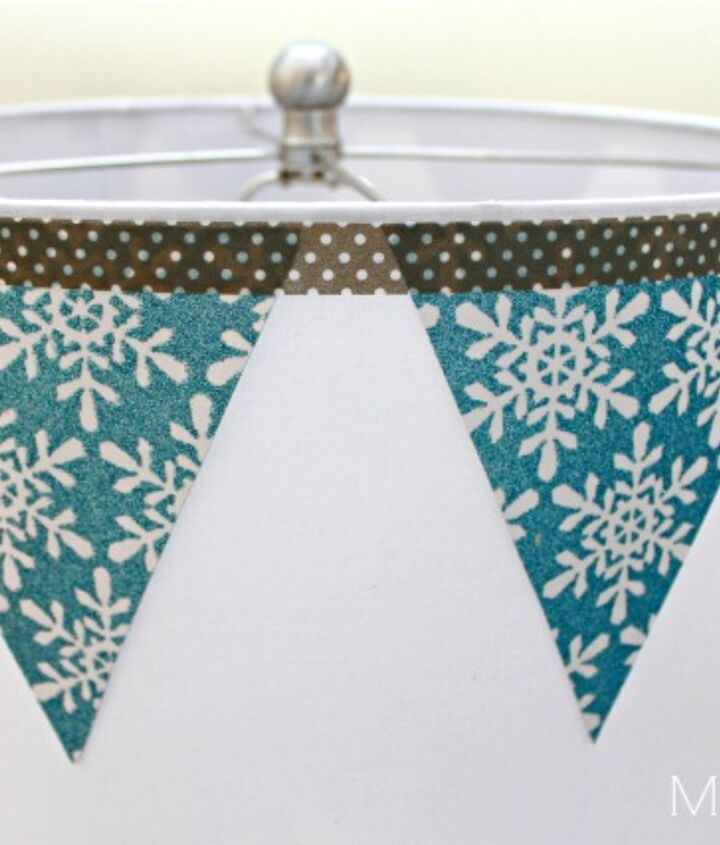 Super easy snowflake bunting with washi tape.  Easy to remove without permanently changing the shade.