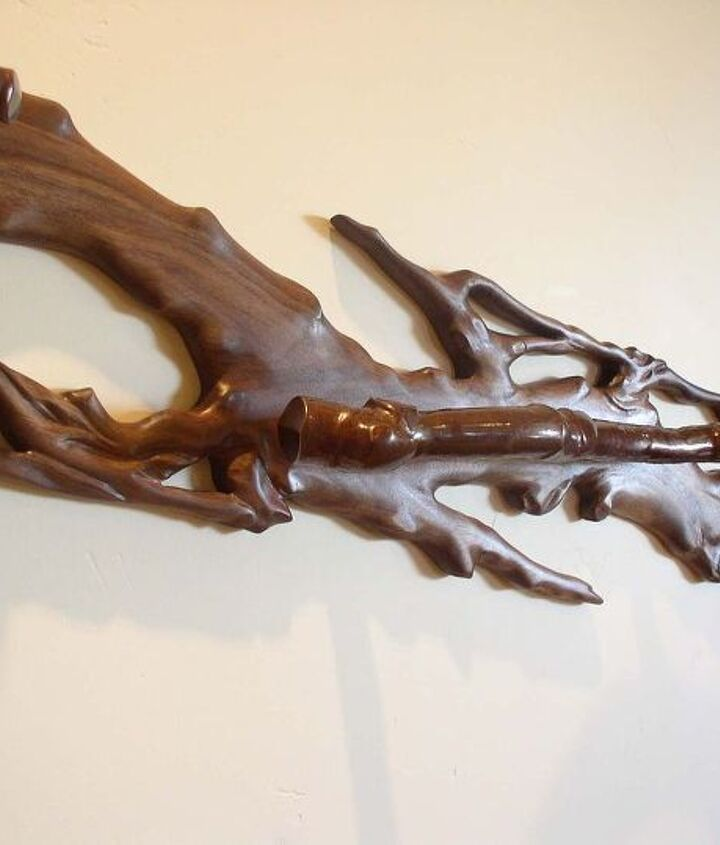 Carved walnut handrail (detail)