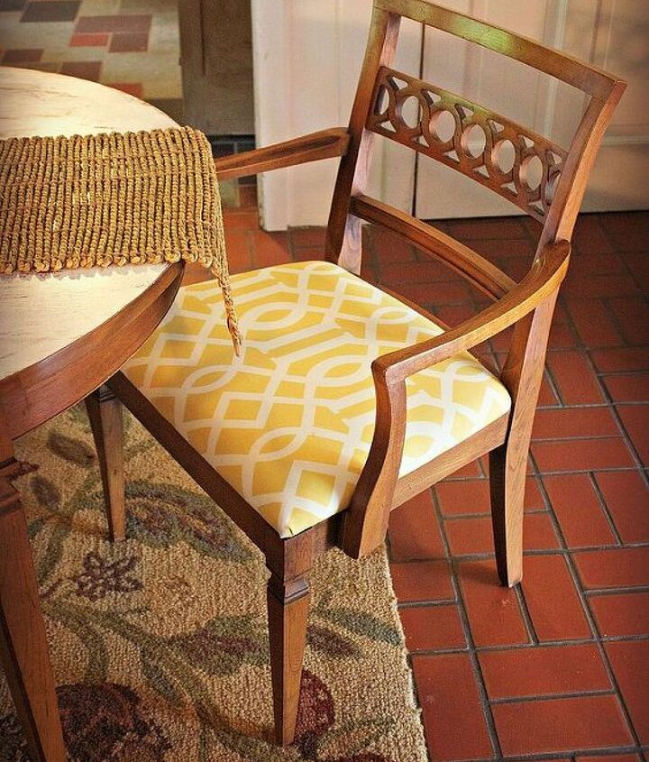 Chairs reupholstered in cheery yellow and white outdoor fabric