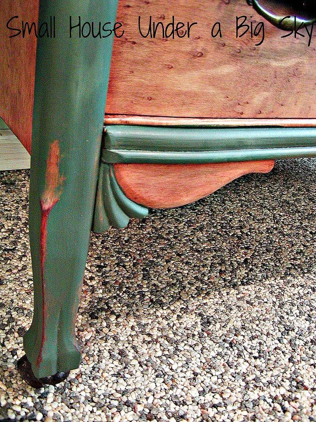 Lightly distressed, carved details on a lovely leg that ends in metal rollers. They don't make them like this anymore!