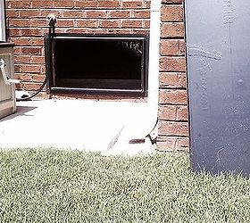 crawl space with cover off sitting at right side of the pic