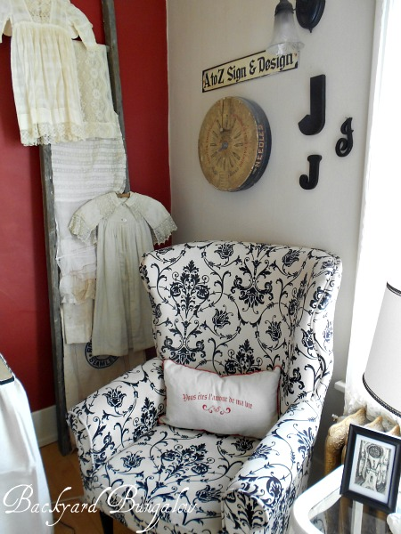 The chairs were purchased at Pier 1.  The round thing behind the chair is an old needle display.