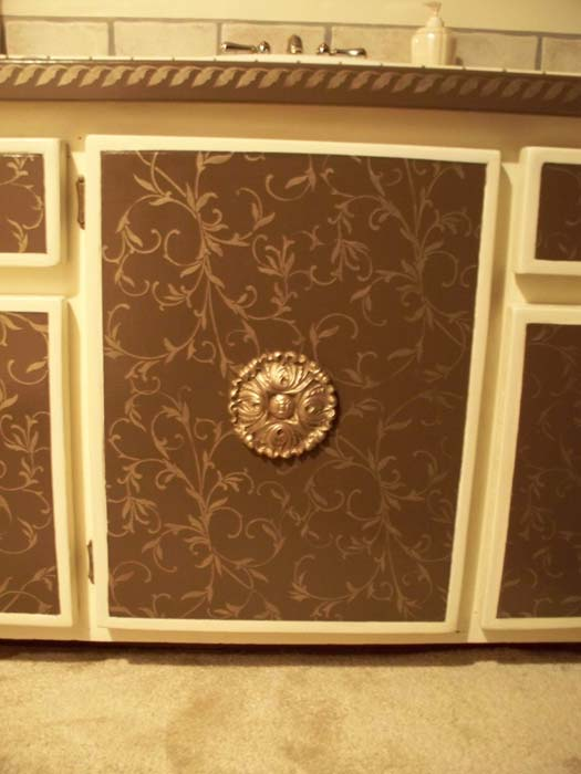 Plaster molds are great for creating a beautiful ornament for cabinets and furniture. I only need one medallion to affix to the center of the door to complete the look.