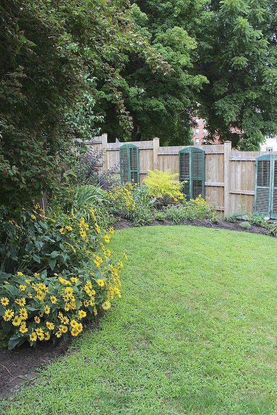 This year, we took the three sets apart and hung them on the long fence line, one per panel in my secret garden