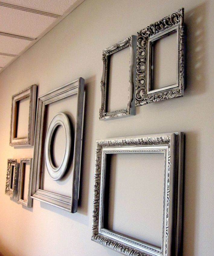 empty frame wall, home decor, Add interest to a big blank wall with spray painted thrift store frames Layer them for additional interest