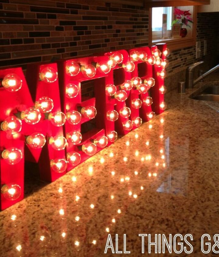 DIY marquee letters made out of cardboard letters and a string of lights.