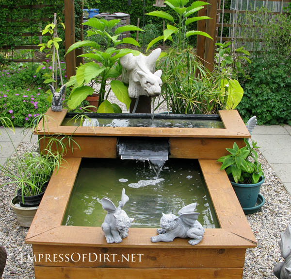 Waterfall made from tiered raised bed ponds. http://www.empressofdirt.net/more-garden-container-ideas/