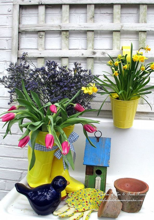 rain boots filled with tulips & statice on the potting sink